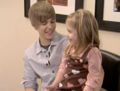 Justin Bieber Finally Makes That Little Girl Stop Crying (VIDEO)