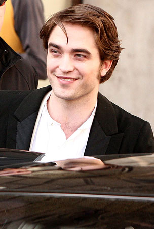 Robert Pattinson Lets His Hair Down On The Set Of 'Bel Ami' (PHOTOS)