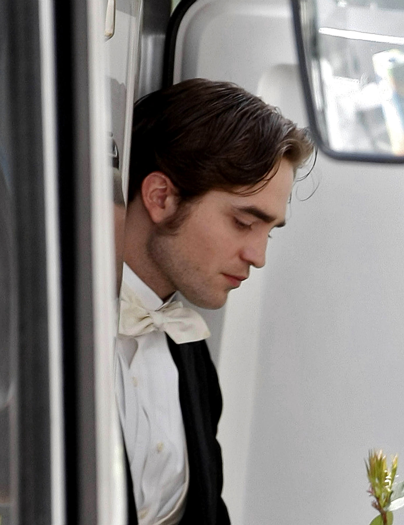 Robert Pattinson Rubs His Awesome Sideburns In Our Faces on 'Bel Ami' Set (PHOTOS)