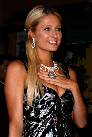 BUZZINGS: Paris Hilton Has a Private Spray Tanning Assistant