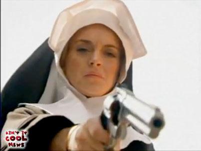 Lindsay Lohan Dresses Up As a Nun With a Gun (VIDEO)