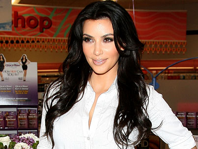 BUZZINGS: Kim Kardashian Says Her Boobs Are to Cry For