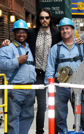 Russell Brand Gets in on a Sewer Thing (PHOTOS)