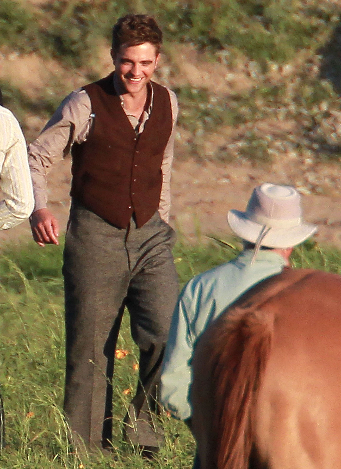 Robert Pattinson Rocks a Vest on 'Water for Elephants' Set (PHOTOS)