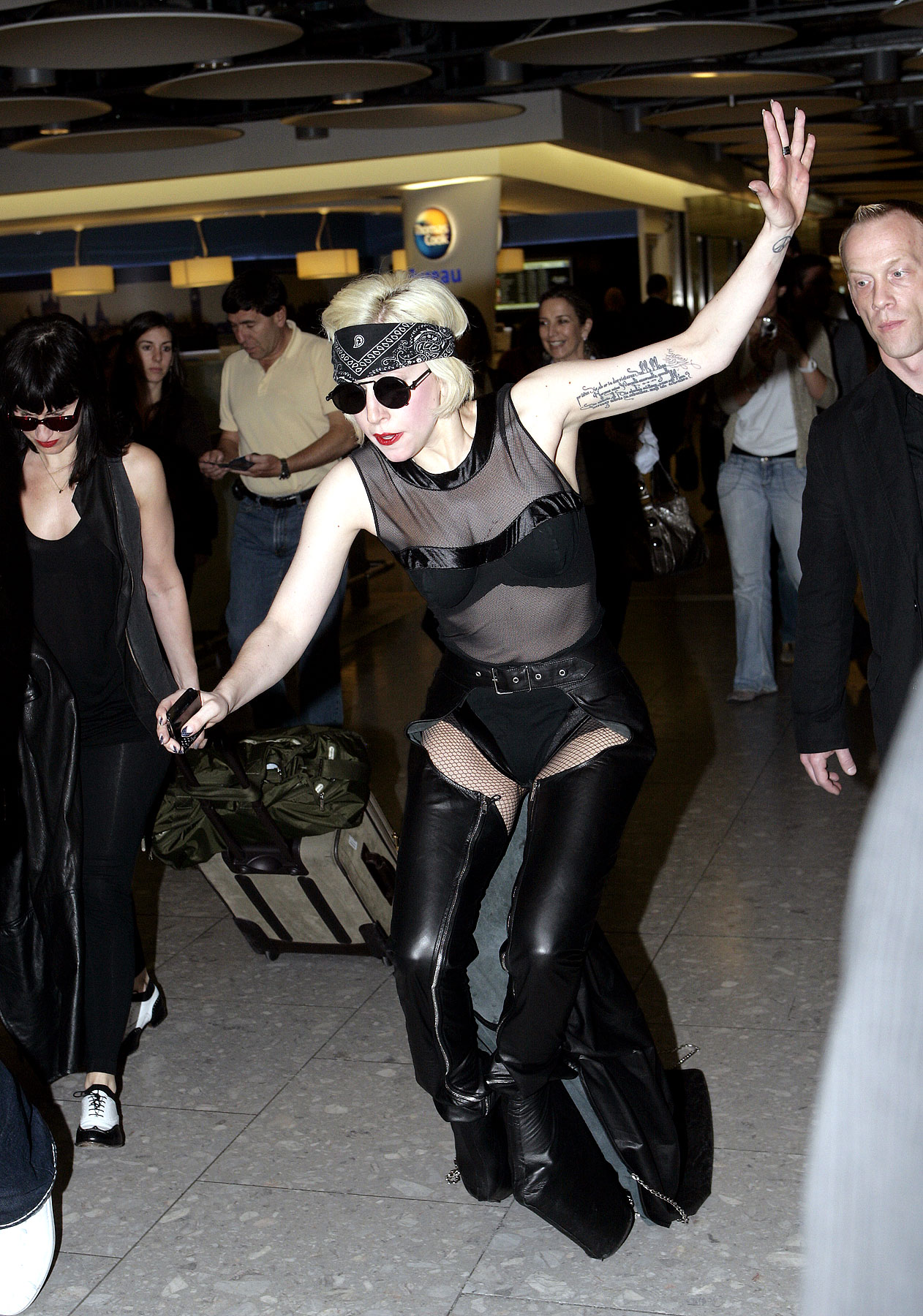 Lady Gaga Trips Over Sky-High Shoes At Airport (PHOTOS)