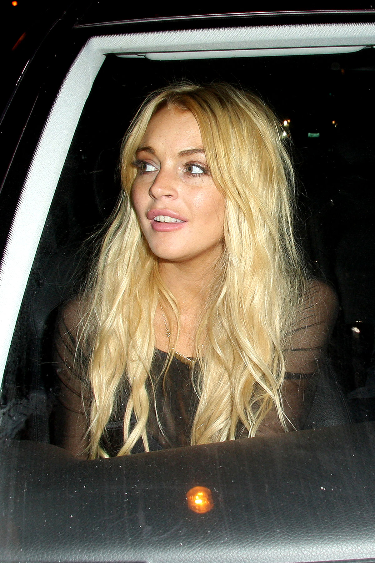 Lindsay Lohan Turns 24, Gets Punched In The Face (PHOTOS)