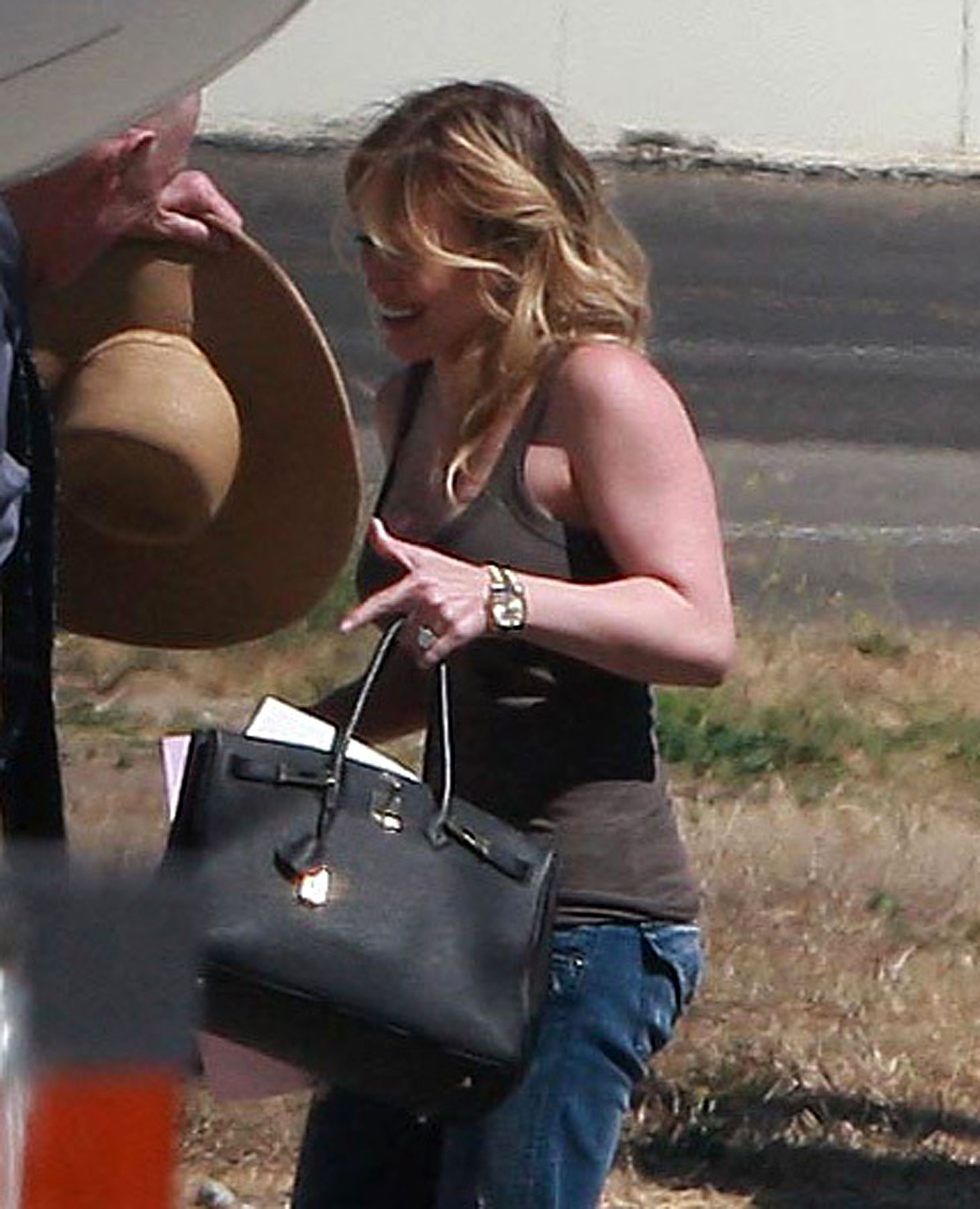 Hilary Duff & Mike Comrie's Post-Wedding Exit (PHOTOS)
