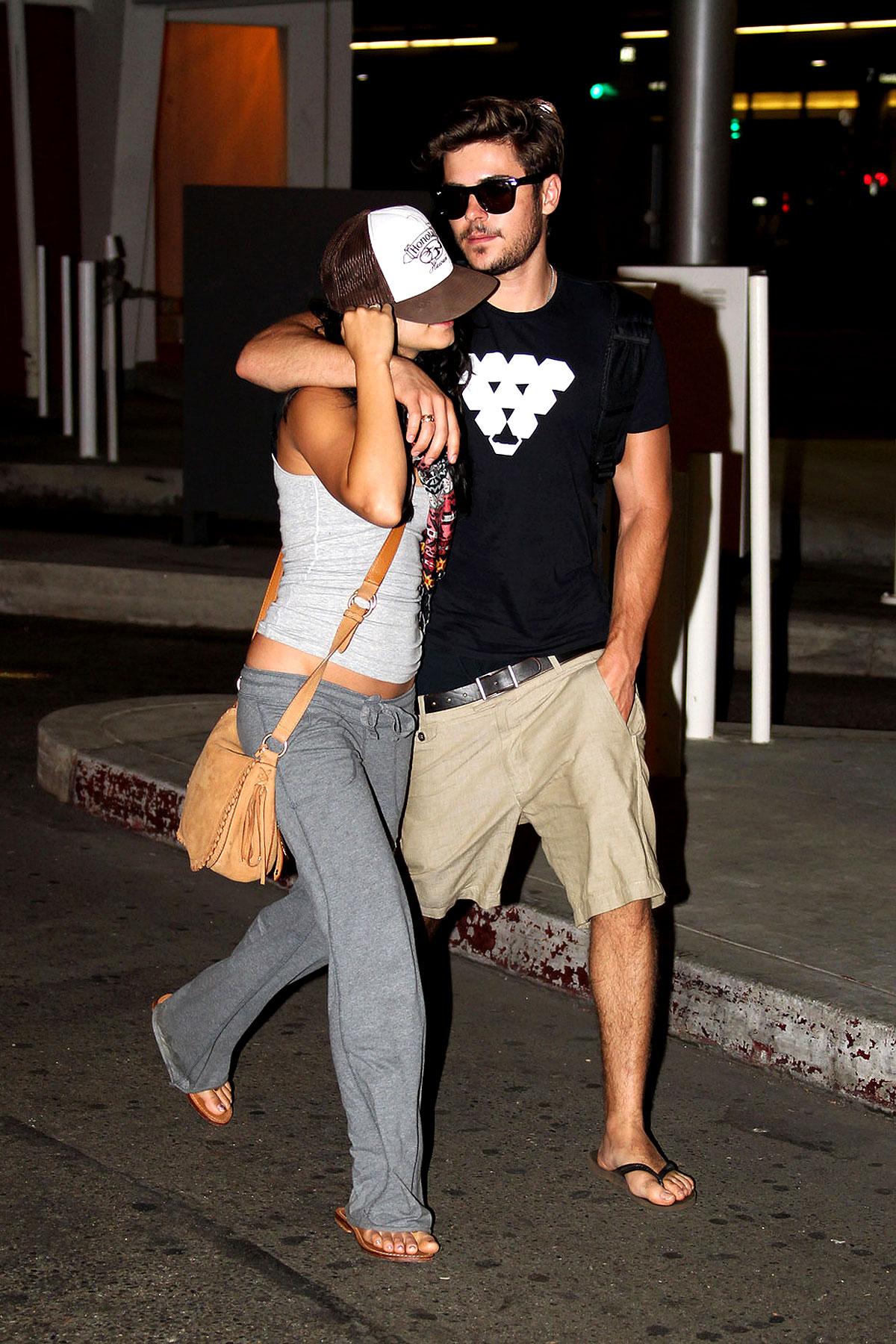 Zac Efron Hides Vanessa Hudgens at LAX (PHOTOS)