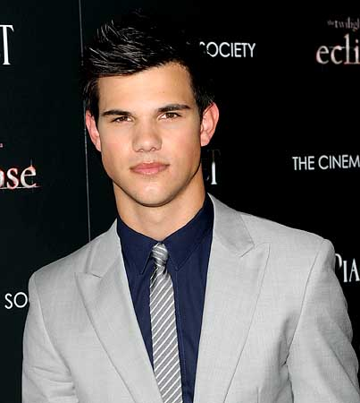 Taylor Lautner Challenged to a Push-Up Contest by Legal Foe