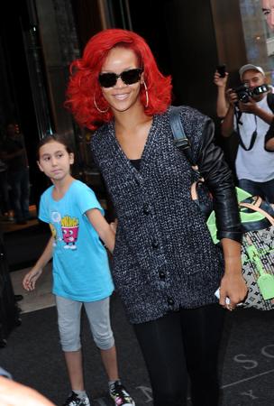Rihanna Greets a Young Fan (PHOTOS)