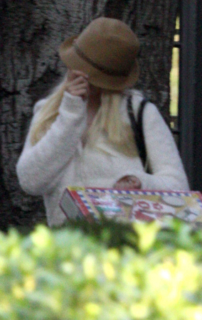Christina Aguilera Hides Behind Her Hat (PHOTOS)