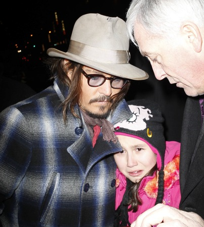 Johnny Depp Saves Young Fan From the Paparazzi