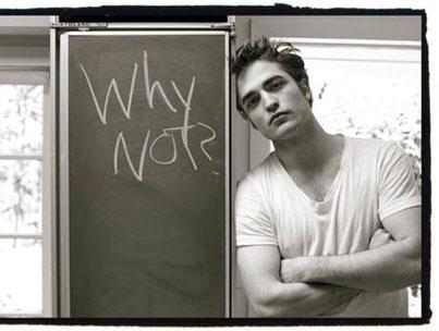 robert pattinson next to a chalkboard